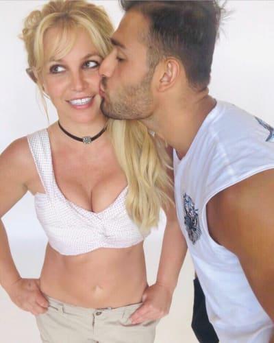 Sam Asghari Gives Britney Spears a Birthday Kiss