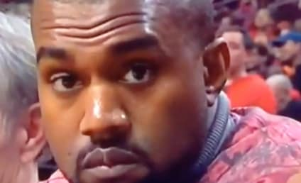 Kanye West Gets Caught Smiling on Camera, Immediately Frowns