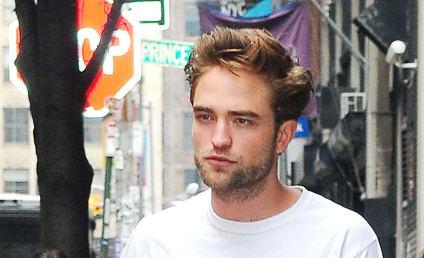 Robert Pattinson and Kristen Stewart Attend Prince Concert