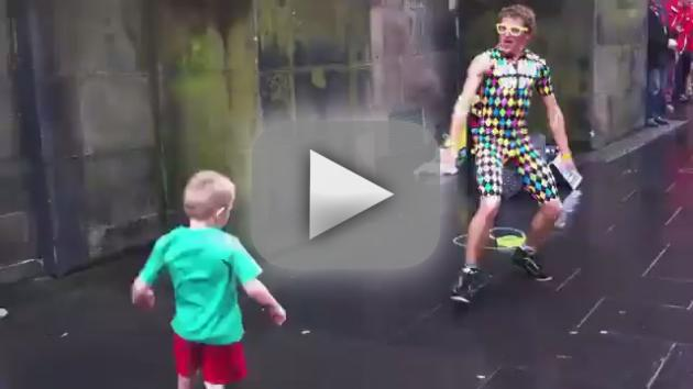 Little Kid Dances With Street Performer