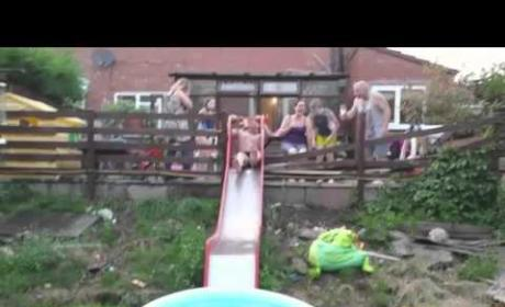 Dad Tries to Fit Down Slide, Fails Miserably