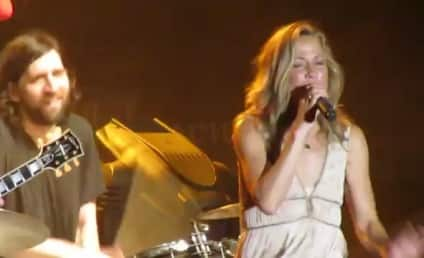 "Sheryl Crow Tries, Fails to ""Soak Up the Sun"""