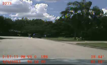 George Zimmerman Police Video: Get on Your Knees!