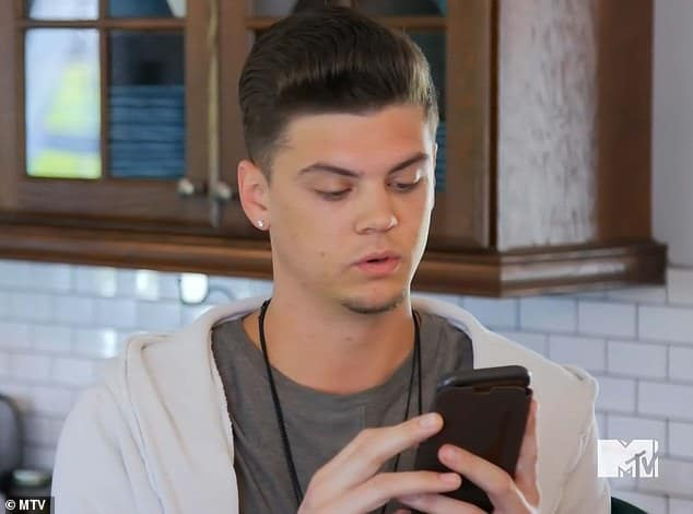 Tyler on his phone