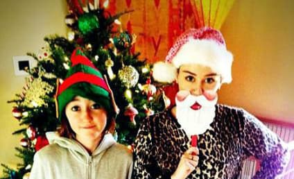 Miley Cyrus Rocks Onesie, Poses with Sister and Dog