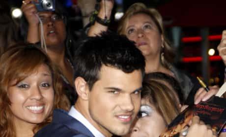 Taylor Lautner Signs for Fans
