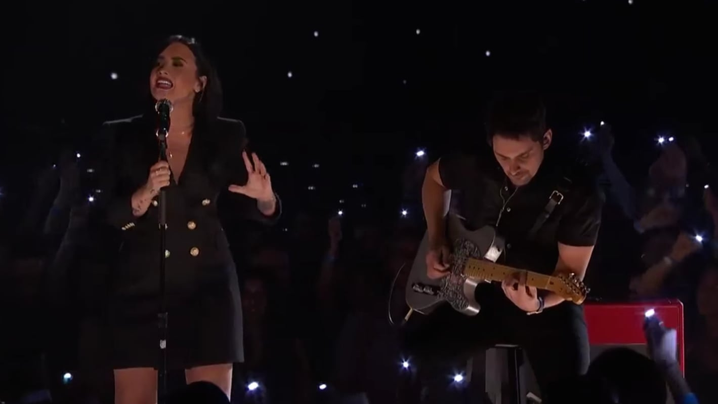 6c40b30265716 Demi Lovato Teams with Brad Paisley at iHeartRadio Music Awards ...