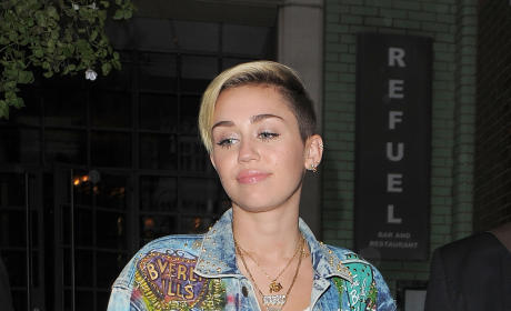 Miley Cyrus in High Boots