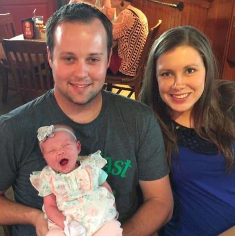 Anna Duggar and Josh Duggar and Child