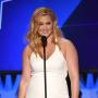 Amy Schumer Looking Gorgeous Talking Into a Microphone Photo
