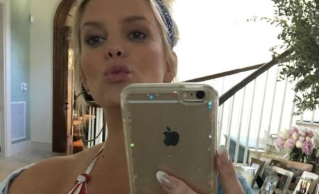 Jessica Simpson Shows Off Cleavage In Red and White Striped Bikini Top