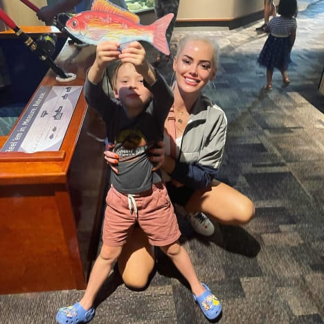 Kathryn Dennis Poses with Her Son at the Aquarium