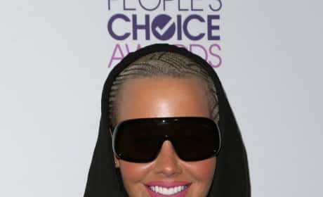 Amber Rose: Kanye West is a F--king Clown!