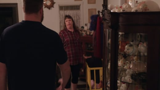Trish shows Mike Youngquist the antique crib