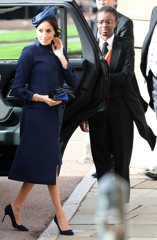 Image result for Meghan was pregnant when she was seen rocking a baby navy blue Givenchy coat