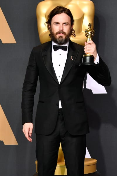 Casey Affleck with an Oscar