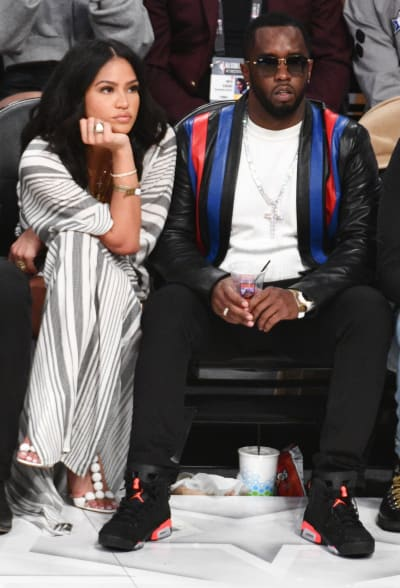Cassie Ventura with Diddy at a Game