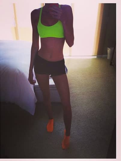 Kendall jenner workout gear the hollywood gossip for Kendall jenner snake tattoo