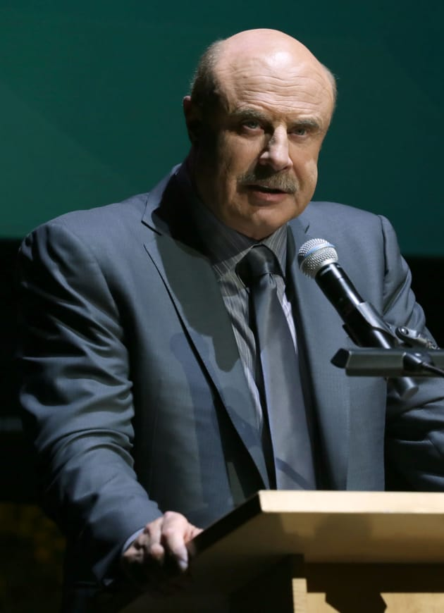 Dr. Phil at a Podium
