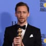 Tom Hiddleston Holds His Globe