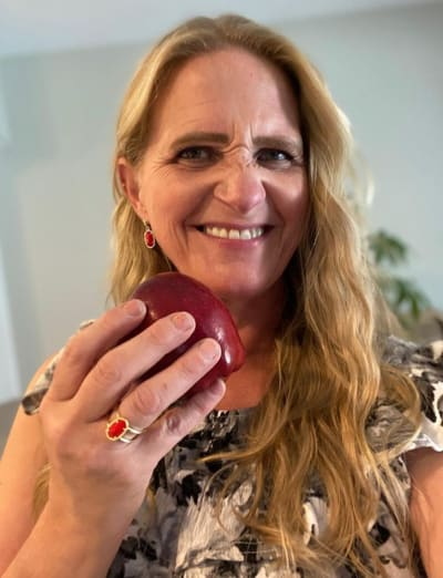 Christine Brown with an Apple