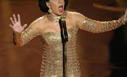 """Shirley Bassey Performs """"Goldfinger,"""" Brings Oscars Crowd to Its Feet"""