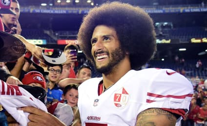 Colin Kaepernick Kneels During Anthem, Makes $1 Million Pledge