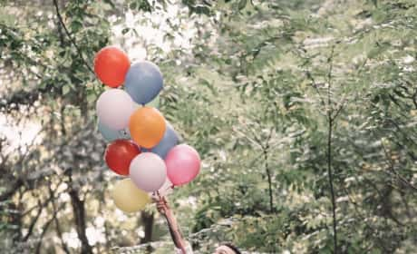 Taylor McKinney & Maci Bookout Reaching For Balloons