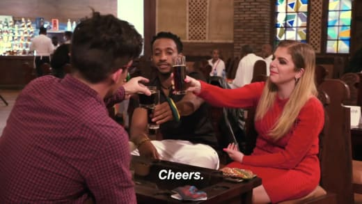 Ariela Weinberg and Biniyam Shibre say cheers