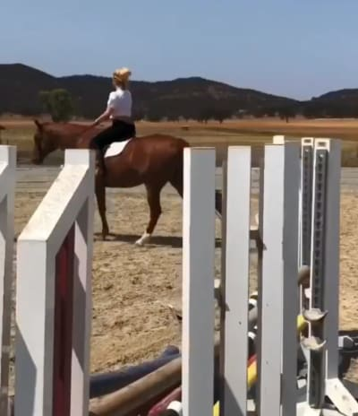Britney Rides a Horse