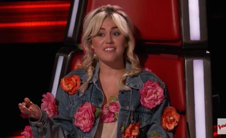 Miley Cyrus in a Red Chair