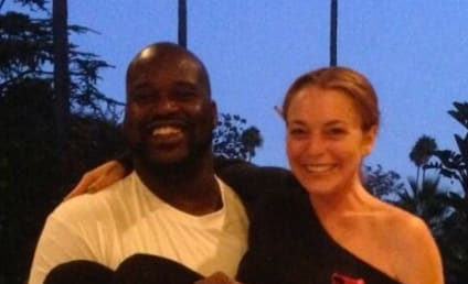 Lindsay Lohan Gets Picked Up By Shaq (But Only Literally)