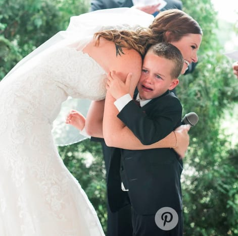 Boy Hugs Bride