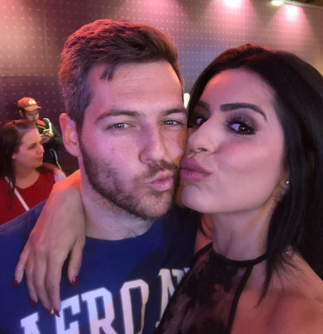 Larissa lima and eric foster make kissy faces