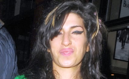 Amy Winehouse Steals Booze From Other Vacation-Goers