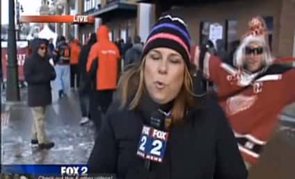 Red Wings Fan Tries, Miserably Fails to Photobomb Reporter