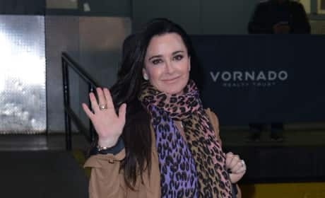 Kyle Richards Waves to the Photogs