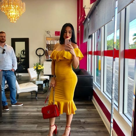 Paola Mayfield Shows Her Baby Bump in a Yellow Dress