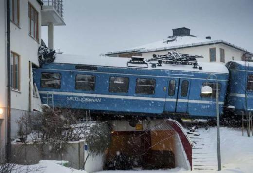 Train Crashes Into Building