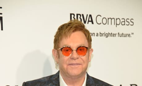 Elton John Has Red Shades