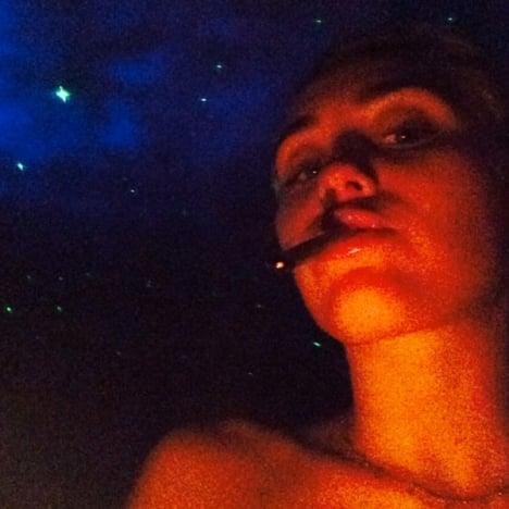 Miley Cyrus Smokes Up