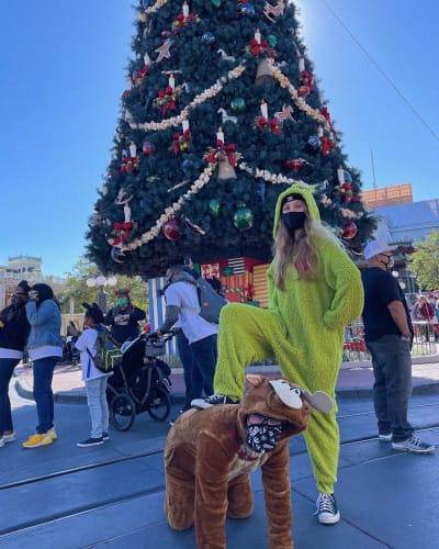 JoJo Siwa and Girlfriend in Grinch Costumes
