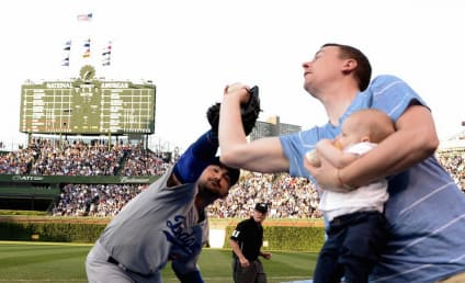 Father Holds Baby, Snares Foul Ball with One Hand