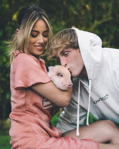 Chloe Bennet and Logan Paul Adopt a Pig