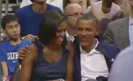 Barack and Michelle Obama: Kiss Cam Alert!