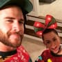 Liam Hemsworth and Miley Cyrus on Christmas