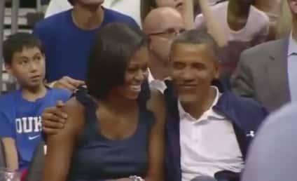 Barack and Michelle Obama: Kiss Cam Alert!