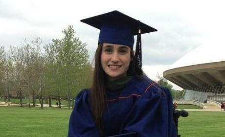 Girl Graduates With Service Dog