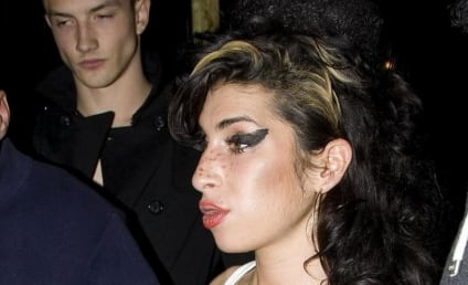 Amy Winehouse Hospitalized with Fake Boob Issue