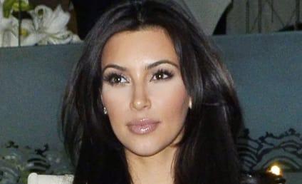 Kim Kardashian Spreads Legs, Awaits Reggie Bush